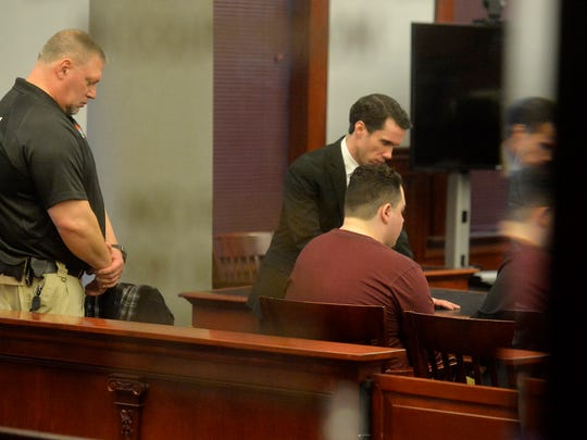 Joseph Knowles sits in a nearly empty courtroom with