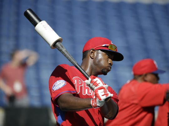Domonic Brown, shown at a Phillies batting practice before a spring training game, hasn't shown much in Triple-A to create much confidence he can help a struggling Phillies offense.