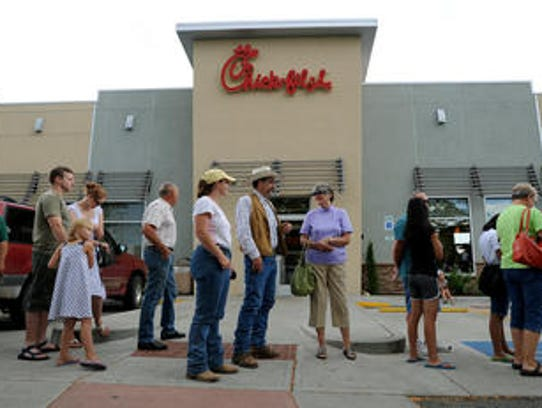 In this 2012 photo, patrons of the Chick-fil-A restaurant