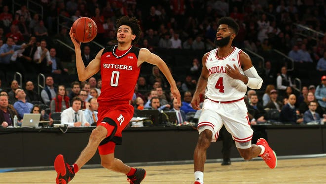 Rutgers Scarlet Knights guard Geo Baker (0) drives to the basket after stealing a pass intended for Indiana Hoosiers guard Robert Johnson (4) during the first half of a second round game of the 2018 Big Ten Tournament at Madison Square Garden.
