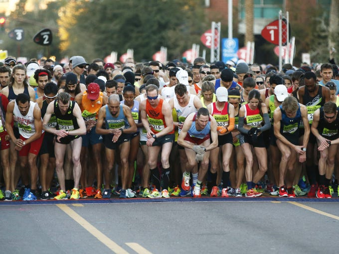 Runners break from the starting line during the Rock