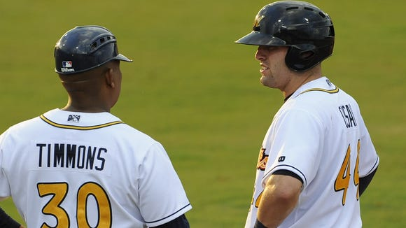 Montgomery Biscuits hitting coach Ozzie Timmons talks with Curt Casali after he got on first base against the Jacksonville Suns at Riverwalk Stadium in Montgomery, Ala. on Thursday July 25, 2013. (Mickey Welsh, Montgomery Advertiser)