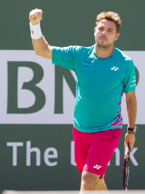 Stan Wawrinka of Switzerland celebrates his semifinal win over Pablo Carreno Busta of Spain on Stadium 1 during the 2017 BNP Paribas Open at Indian Wells Tennis Garden on March 17, 2017.