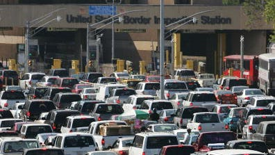 Typical massive lines of cars wait daily to cross into the U.S. from Mexico at the San Ysidro border crossing outside San Diego.