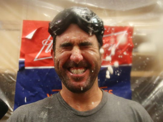 Justin Verlander celebrates in the clubhouse.