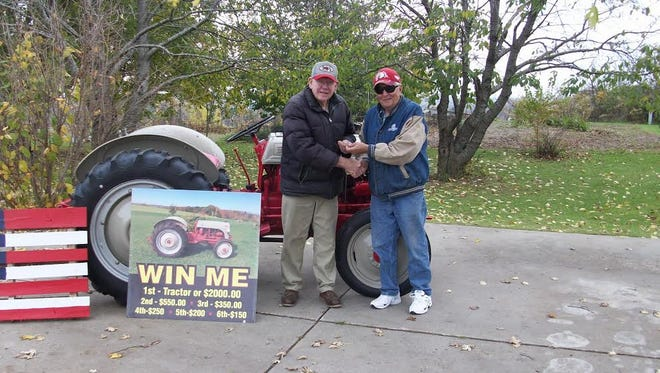 The 2016 Wisconsin Antique Power Reunion raffle winner of a restored 1948 Ford 8N is Roger Rogge of Jackson. Making the official presentation to Rogge is club President Ralph Wiedmeyer (right).