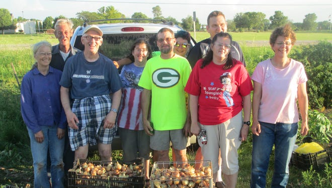 A group of volunteers from The Arc Fond du Lac helped harvest 2,000 onions recently that will be given away to local charities. The crew included, from left: Garden organizers Donna and Chuck Zamzow; and Arc volunteers Donald, Jean, Gary, Sherri, Robbie, Christine and Jill.