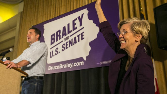 Bruce Braley, left, campaigns with  U.S. Sen. Elizabeth Warren (D-MA) in an  Iowa Votes rally in Des Moines Sunday, October 19, 2014, at the Hotel Fort Des Moines.