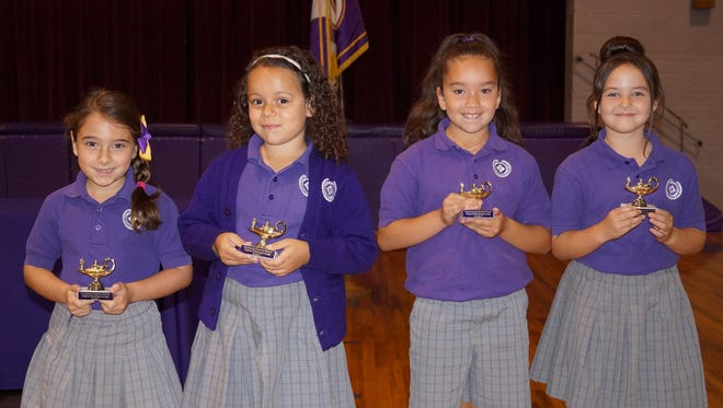 "In the recent Opelousas Catholic School Elementary Awards Program, these first and second grade students were presented with the ""Reading Awards"".  From left, honorees for outstanding reading were Scout Darbonne and Avery Broussard, 1st grade; and Jordan White and Molly Vazquez, 2nd grade."