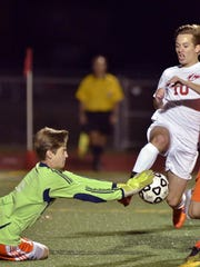 Northville goalkeeper Evan Treiber comes out to deny
