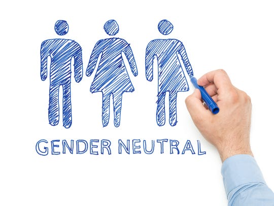 Man drawing the Gender neutral sign on whiteboard