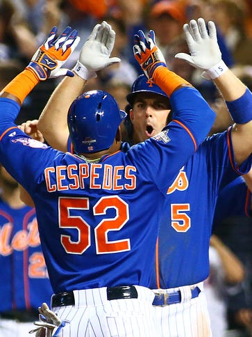 Yoenis Cespedes and David Wright celebrate after Cespedes'