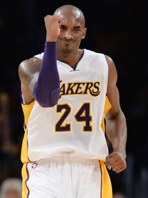 Lakers guard Kobe Bryant pumps his fist during Sunday's win against the Hornets.