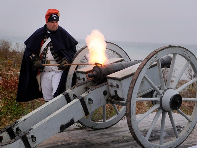 Historical interpreter Stevan Hamann fires a charge