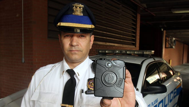 White Plains police Lt. Todd Moskalik holds one of the department's body cameras at the White Plains Police headquarters April 21, 2015.