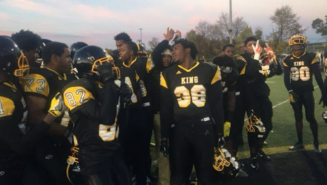 Detroit King celebrates their win over Temperance Bedford Saturday.