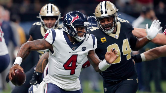 Houston Texans quarterback Deshaun Watson (4) scrambles as New Orleans Saints defensive end Cameron Jordan (94) pursues in the first half of an NFL football game in New Orleans, Monday, Sept. 9, 2019. (AP Photo/Bill Feig)