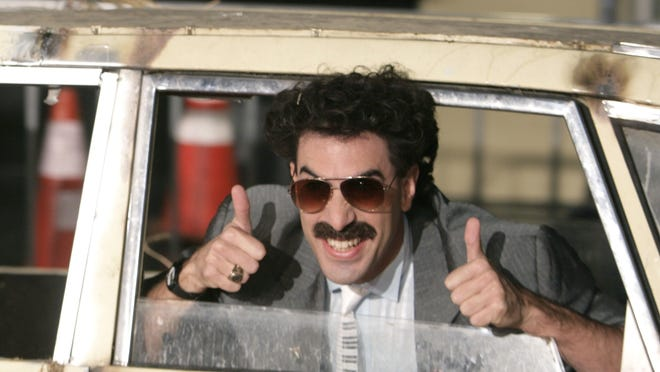 """FILE - In this Monday, Oct. 23, 2006, file photo, actor Sacha Baron Cohen arrives in character as Borat for the film premiere of """"Borat: Cultural Learnings of America for Make Benefit Glorious Nation of Kazakhstan,"""" in the Hollywood section of Los Angeles. Borat is back. Sacha Baron Cohen has filmed a sequel to his 2006 film """"Borat: Cultural Learnings of America for Make Benefit Glorious Nation of Kazakhstan†that Amazon plans to release before the 2020 election."""