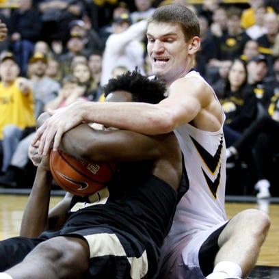 Iowa center Adam Woodbury, has secured the following