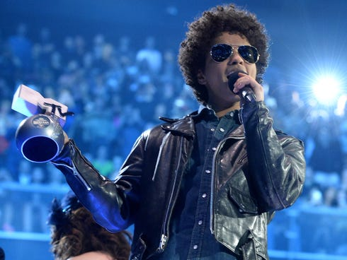 Bruno Mars accepts the Best Song award onstage during the MTV EMA's 2013 in Amsterdam, Netherlands.