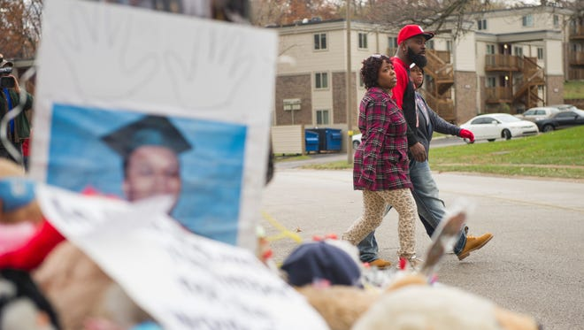 Michael Brown Sr. delivers turkeys to residents along Canfield Drive, near the site where his son, Michael Brown, was killed, in Ferguson, Mo.