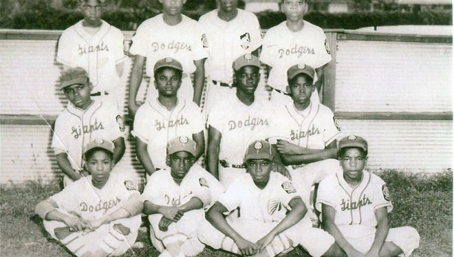 Members of the first black Little League baseball team in Knoxville formed in 1953. From left to right, top row, Chubby Parris, Melvin George, Hoyle Davis, Ralph Woods. Second row, Harold Thompson, Jimmy Kitchen, Harold Weems, Calvin Dirl. Bottom row, James Jeter, Marshall Freeman, Carl Gable Jr., Louis Troutman.