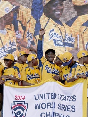 members of the Jackie Robinson West All Stars Little League baseball team participate in a rally in Chicago celebrating the team's U.S. Little League Championship. Little League International has stripped Chicago's Jackie Robinson West team of its national title after finding the team falsified its boundary map. The league made the announcement Wednesday morning, Feb. 11, 2015, saying the Chicago team violated regulations by placing players on the team who didn't qualify because they lived outside the team's boundaries. Little League International also suspended Jackie Robinson West manager Darold Butler from league activity.