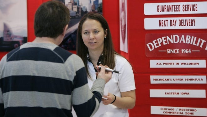 Jessie Pope, a human resources recruiter for N&M Transfer Co., Inc., in Neenah speaks to a prospective employee during a job fair.