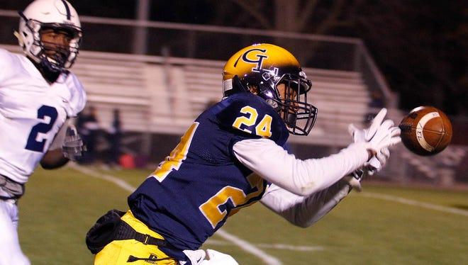 Antonio Rush (24) and Grand Ledge are one of three unbeaten football teams in mid-Michigan.