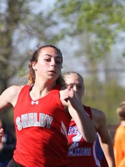 Shelby's Elya John competes in the 100 meter dash at