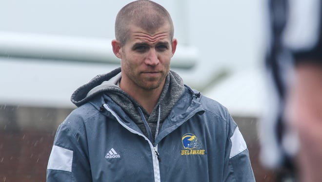 Green Bay Packers All-Pro receiver Jordy Nelson walks onto the field as Blue Hens spring football practice begins Saturday.