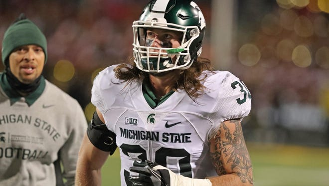 Oct 22, 2016; College Park, MD, USA; Michigan State Spartans linebacker Riley Bullough (30) is ejected from the game in the first quarter against the Maryland Terrapins at Byrd Stadium. Mandatory Credit: Mitch Stringer-USA TODAY Sports