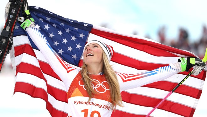 Coloradan Mikaela Shiffrin celebrates winning the silver medal in the ladies alpine skiing combined event. She's contributed two medals to Colorado's total of nine so far.