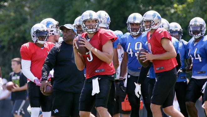 Lions quarterbacks Matthew Stafford (9) and Dan Orlovsky (8) drop back to pass during training camp Aug. 4, 2016 in Allen Park, Mich.