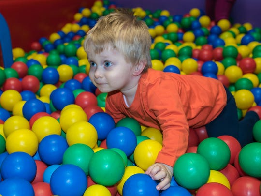 Activities like climbing through a ball pit can be one way occupational therapists treat Sensory Processing Disorder.