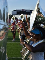 Zada Perry, a 16-year-old Clinton High School junior, practices during band camp on the Clinton High School football.