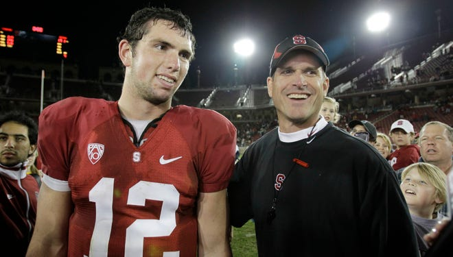 Andrew Luck (12) and Jim Harbaugh spent three years together at Stanford.