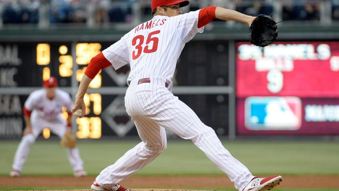 Phillies starting pitcher Cole Hamels throws a pitch during the second inning against the Cincinnati Reds at Citizens Bank Park.