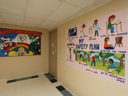 "Artwork on the wall, including a ""My Safety Plan"" in"