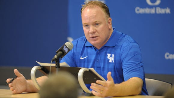 UK Head Football Coach, Mark Stoops, speaks during the University of Kentucky football media day at the UK Nutter Training Center in Lexington, KY. Friday, August 8, 2014.