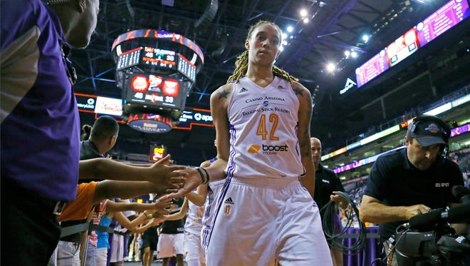 Phoenix Mercury center Brittney Griner (42) greets fans during halftime of their 90-78 win over the Washington Mystics  on July 15, 2014.