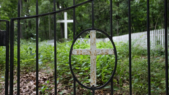 The gate for the Industry Residential Center graveyard in Rush.