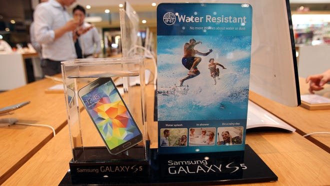 A Samsung Electronics' Galaxy S5 smartphone is displayed at the company's showroom in Seoul, South Korea. Samsung Electronics Co. reported a bigger-than-expected fall in second quarter profit on Thursday and said it was uncertain if earnings from its handset business would improve in the current quarter.