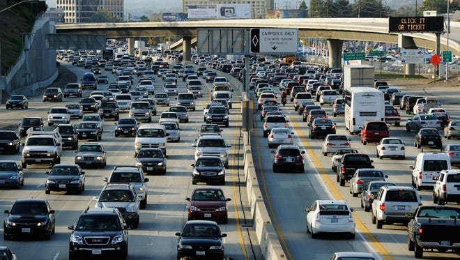 Rush hour traffic in Los Angeles, where people participate in many activities while driving