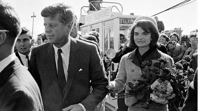 President John F. Kennedy and his wife, Jacqueline Kennedy, arrive at Love Field airport in Dallas.