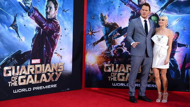"""Chris Pratt, left, and his wife Anna Faris arrives at the premiere of """"The Guardians Of The Galaxy"""" at El Capitan Theatre on Monday, July 21, 2014, in Los Angeles. (Photo by Jordan Strauss/Invision/AP)"""
