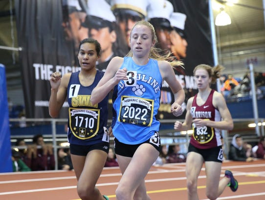 Ursuline's Lily Flynn runs the mile invitational at