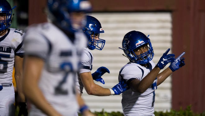 Barron Collier's Jayden Rolle, far right, celebrates with the rest of his teammates after scoring a touchdown against First Baptist Academy in the second half of action Friday, September 1, 2017 in Naples. Barron Collier would go on to win 42-19.