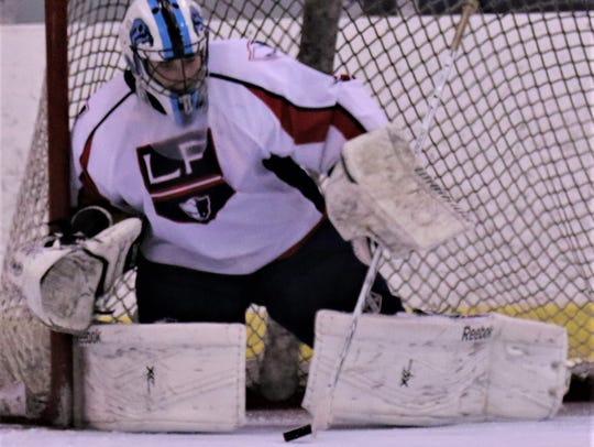 Making one of 38 saves Wednesday against Salem is Livonia