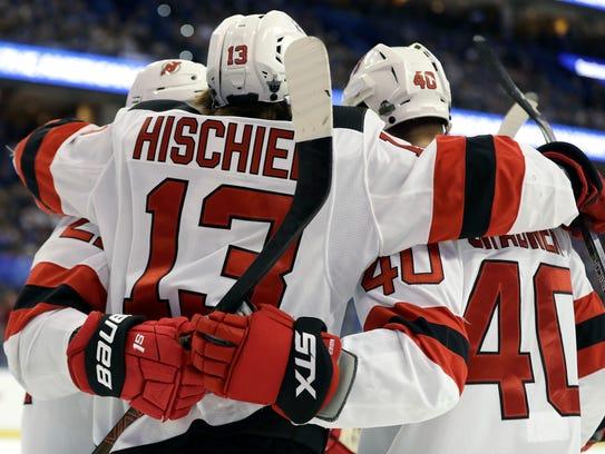 New Jersey Devils center Nico Hischier (13) celebrates
